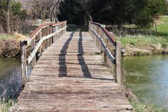 Neat old wooden bridge across the platte river. In Tooley Park Marquette Nebraska royalty free stock photos