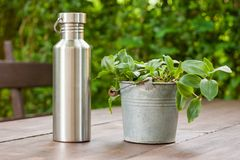 Neat reusable stainless steel bottle. Durable, high quality reusable stainless steel bottle as alternative to plastic bottles. Toxin, BPA, plastic free zero royalty free stock photos