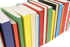 Books in a row, diagonal, white background. Book row : Row of colorful books isolated on white background Stock Photography