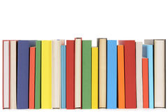 Library books in a row, isolated white background. Row of colorful books isolated on a white background Stock Image