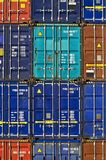 Cargo containers row stack pile. Cargo containers neatly stacked and piled atop each other at the loading dock. product import export trade commerce industry stock image
