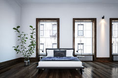 Neat spacious minimalist black and white bedroom Stock Image