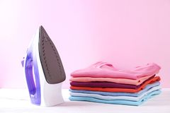 Composition with folded clothes, unisex for both man and woman, different color & material. Pile of laundry, dry clean clothing. Neat stack of clean freshly royalty free stock photography