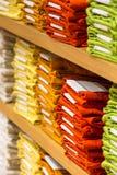 Neat stacks of folded clothing Stock Photo