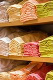 Neat stacks of folded clothing Stock Images