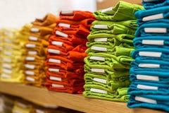 Neat stacks of folded clothing. On the shop shelves Stock Photo