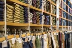 Neat stacks of folded clothing. On the shop shelves Stock Image