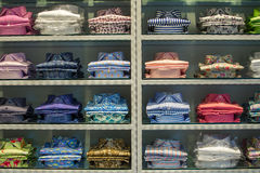 Neat stacks of folded clothing. On the shop shelves Royalty Free Stock Photos