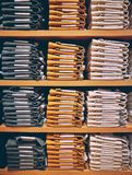 Neat Stacks Of Folded Clothing On The Shop Shelves. Close Up Of Neat Stacks Of Folded Clothing On The Shop Shelves Royalty Free Stock Photos