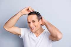 Neat, trendy, experienced, stylish, brunet, positive man looking royalty free stock photo