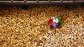Neat Wood Stack with Flowers Royalty Free Stock Photography