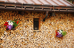 Neat Wood Stack with Flowers 1 Royalty Free Stock Image