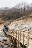 Neat wooden walk way at Noboribetsu Jigokudani Hell Valley: The volcano valley got its name from the sulfuric smell. Neat wooden walk way at Noboribetsu royalty free stock photography