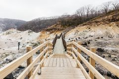 Neat wooden walk way at Noboribetsu Jigokudani Hell Valley: The volcano valley got its name from the sulfuric smell. Stock Images