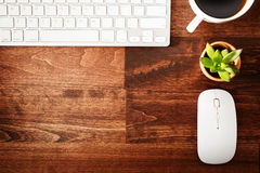 Neat workstation on a wooden desk Royalty Free Stock Photo