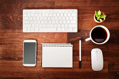 Neat workstation on a wooden desk Stock Images
