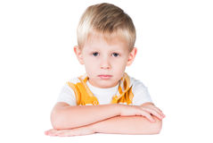 Neat young boy sitting at table isolated Royalty Free Stock Images