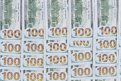 Neatly arranged background of 100 dollar bills Royalty Free Stock Photo