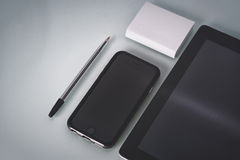 Neatly arranged tablet computer and smart phone Stock Photos