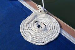 Neatly coiled nylon rope royalty free stock photography