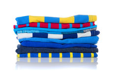 Neatly folded colourful summer shirts on a white Stock Photos