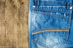 Neatly folded jeans on wooden background Stock Images