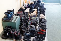 Neatly lined up winter boots royalty free stock photos