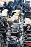 Neatly lined up winter boots. Sixty five pairs of winter boots neatly lined up in a Quebec cross country ski station stock image
