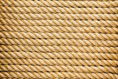 Neatly organised parallel strands of rope. Neatly organised parallel strands of a thick new natural fiber rope arranged horizontally in a full frame texture Stock Images