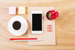 Neatly organized stationery and cellphone Stock Images