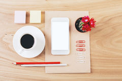Neatly organized stationery and smartphone Royalty Free Stock Images