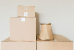 Neatly Packed Moving Boxes In an Empty Room Stock Photos