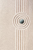 Neatly raked patterns in a Japanese Zen Garden. Neatly raked patterns in the sand in a Japanese Zen Garden with parallel lines and concentric circles with a Stock Images