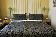 Neatly set double bed Stock Photos
