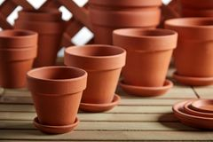 Neatly stacked clay pots on a wooden board stock photography