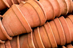Neatly stacked flower pots. Neatly stacked clay flower pots used for gardening Stock Photo