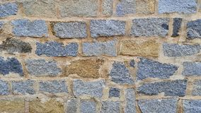 Neatly stacked rough cut stone wall texture background Stock Photography