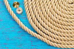 Neatly wound and coiled rope with compass Royalty Free Stock Images