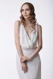 neatness Молодая тихая женщина в светлом платье Стоковая Фотография RF