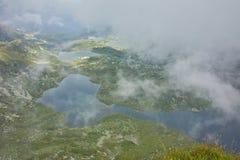 Nebbia d'avvicinamento sopra il gemello, il trifoglio, il pesce ed i laghi più bassi Fotografia Stock Libera da Diritti