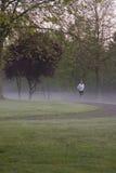 Nebelhafter Morgen-Lack-Läufer Stockfoto