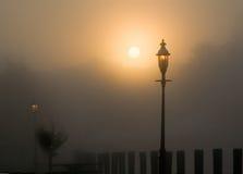 Nebeliger Sonnenaufgang Stockbild