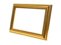 Neben dem alten antiken Goldrahmen lokalisiert auf weißem Hintergrund Lizenzfreies Stockfoto