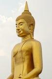Neben großem goldenem Buddha Lizenzfreie Stockbilder