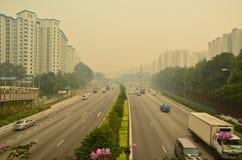 Neblina en la carretera de Singapur Fotografía de archivo libre de regalías