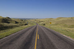 Nebraska Highway. A highway leading to a lake and traveling through sandhills Stock Image
