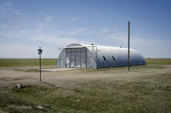 Nebraska Quonset Hut. An isolated quonset hut sits along side a backroad in the middle of Nebraska farmland Stock Photography