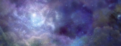 Nebula in Outer Space. Deep space wide blue banner showing Nebula system and cloud formation Royalty Free Stock Image