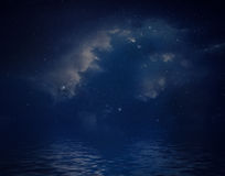 Nebula and stars reflected in water. Royalty Free Stock Photos