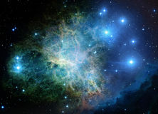 Nebula and stars in space. Far being shone nebula and stars field against space.Elements of this image furnished by NASA Royalty Free Stock Photos